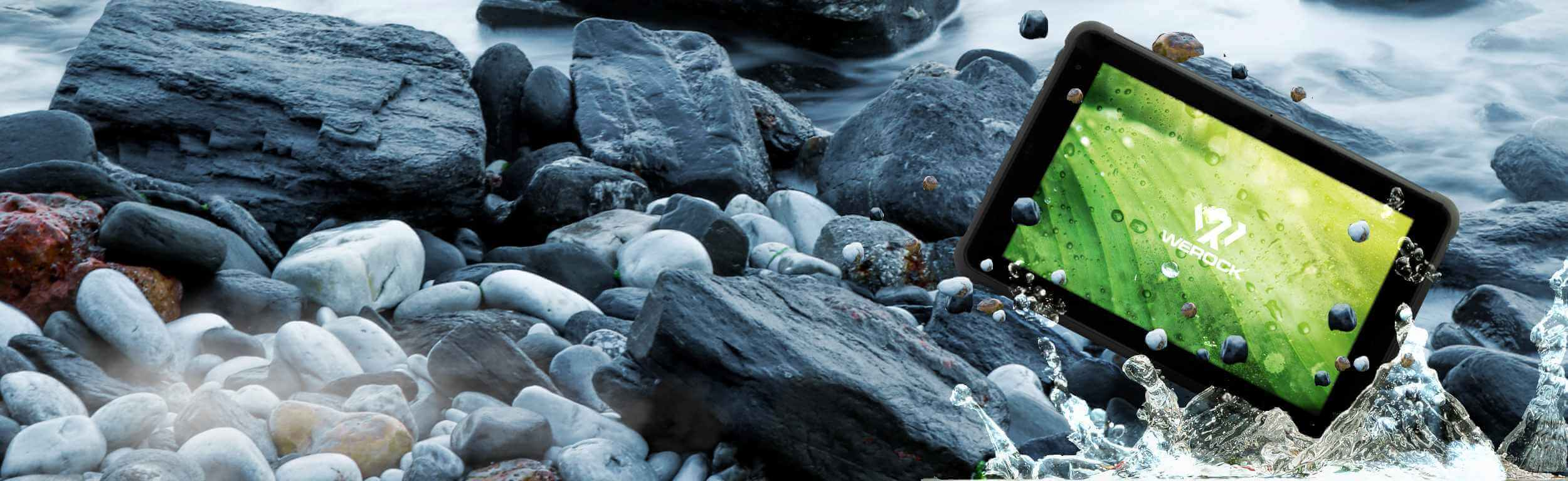 Rocktab S110 Rugged Tablet falling down into a river with stones causing some splashing